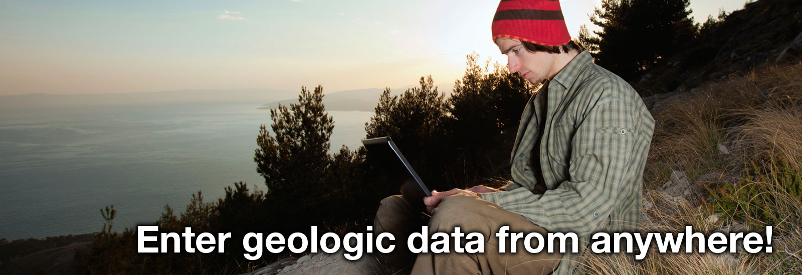 A young geologist enters data into the EDM. Caption: 'Enter geologic data from anywhere'